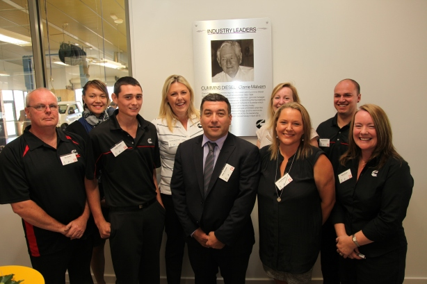 Cummins South Pacific staff in front of the plaque recognising Cummins Australia pioneer Clarrie Malvern. From left: Neil Kinder (technician) Fallon Te Paa (intern), Leigh Travis (3rd year mechanical apprentice), Rachael Reinheimer (manager – marketing and events), Mick Cristaldi (branch manager – Laverton), Penelope Walter (director – workplace and community environment), Vicki Pafumi (corporate responsibility contractor), Matt Smakman (4th year mechanical apprentice), Kate Evans (apprentice program manager).